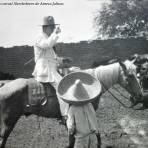 Hacendado con su Peon en Tipico corral Alrededores de Ameca Jalisco..