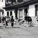 Lugar desconocido vendedores en la calle.