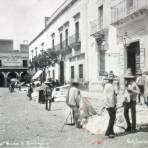 Escena callejera y Mercado por los fotografos Fox y Carmichael.